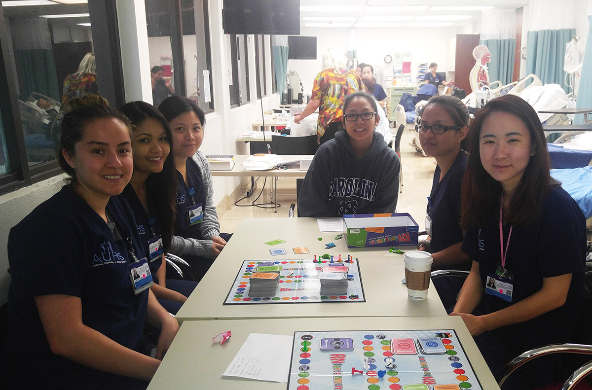 AUHS Nursing Students Plays Board Game to Study for Finals